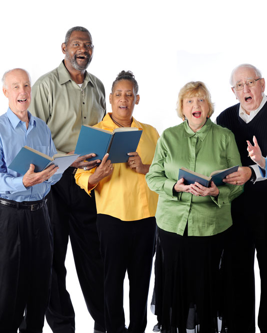 Group of seniors singing music together as a group